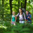 Group of young hikers in the mountains — Stock Photo