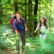 Young couple hiking in a forest — Stock Photo