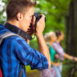 Hiking photographer taking pictures — Stock Photo