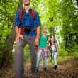 Man on a mountain trail with friends — Stock Photo