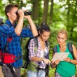 Hikers with map and binocular — Stock Photo