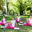 Women stretching on  mats — Stock Photo