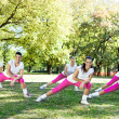 Group of women stretching legs — Stock Photo