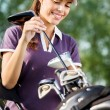 Smiling female golfer — Stock Photo