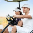 Stock Photo: Couple in golf car