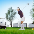 Stock Photo: Golfer hitting golf ball
