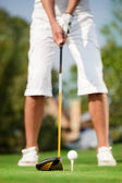 Close up shot of golfer ready to tee off — Stock Photo