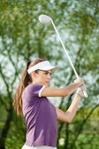 Golfer shooting a golf ball — Stock Photo