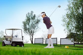 Golfer hitting golf ball — Stock Photo