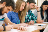 Students having a test in a classroom — Stock Photo