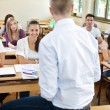 Students on lecturer — Stock Photo