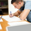 Male high school student in classroom — Stock Photo