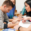 Young students sitting together with notes — Stock Photo #30404121