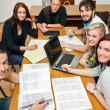 Stock Photo: Happy friends studying together