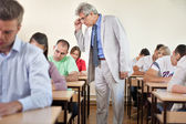 Professor with classroom full of students — Stock Photo