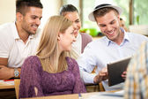 Group of happy students with tablet pc — Stockfoto