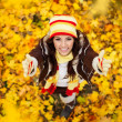 Stock Photo: Happy smiling girl in autumn park