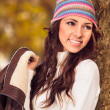 Young woman in a romantic autumn scenery — Stock Photo