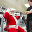 Santa with personal trainer in the gym — Stock Photo