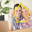 Happy young couple moving in new home — Stock Photo #31882389