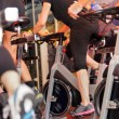 Indoor bicycle cycling in gym — Stock Photo #31882575