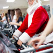 Santa workout on a treadmill — Stock Photo