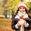 Girl feeling cold in autumn park — Stock Photo