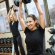 Woman with lifting weights — 图库照片