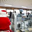 Santa at gym — Stock Photo