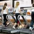 People running on machines, treadmill — Stock Photo