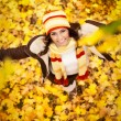 Girl in autumn orange leaves, outdoor — Stock Photo