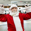 Santa Claus  doing exercise at gym — Stock Photo