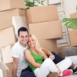 Cute couple on floor their new apartment — Stock Photo