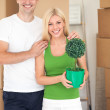 Young couple is hugging in new home — Stock Photo