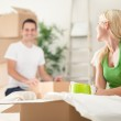 Young couple unpacking moving boxes — Stock Photo #31883957