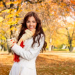 Stock Photo: Smiling woman in autumn park