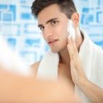 Man putting on shaving cream — Stock Photo