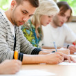 College student trying to copy test — Stock Photo #31885447