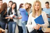 Student holding notebook — Stockfoto