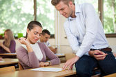 Teacher instructing student — Stock Photo
