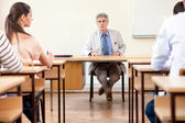 Teacher with students in classroom — Stock Photo