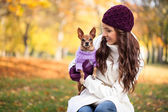 Beautiful woman and his dog — Stock Photo