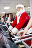 Santa workout on a treadmill — Stock Photo