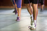 Muscular legs with a resistance band — Stock Photo