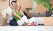 Happy couple with key of new home — Stock Photo
