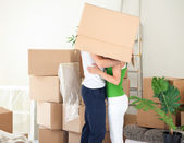 Couple kissing under the box — Stock Photo