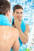 Satisfied handsome man aftershave — Stock Photo