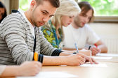 College student trying to copy test — Stock Photo