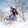 Couple sledging through — Stock Photo