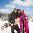 Couple on ski holiday in mountains — Stock Photo